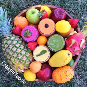 Smoothies surrounded by tropical fruit